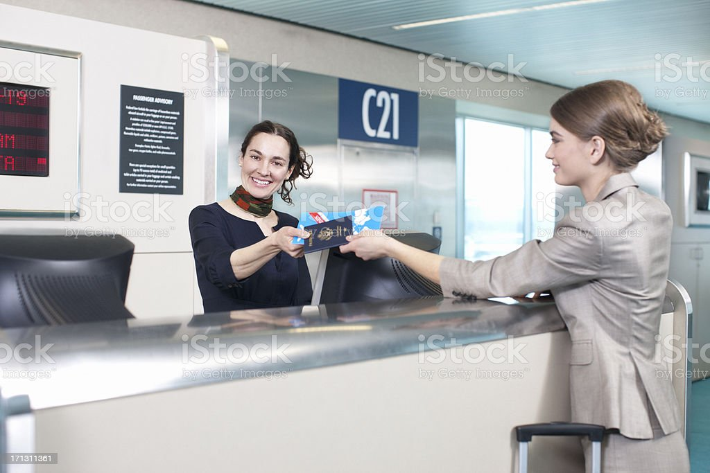 Ticket Agent at Airport Helping Passenger stock photo