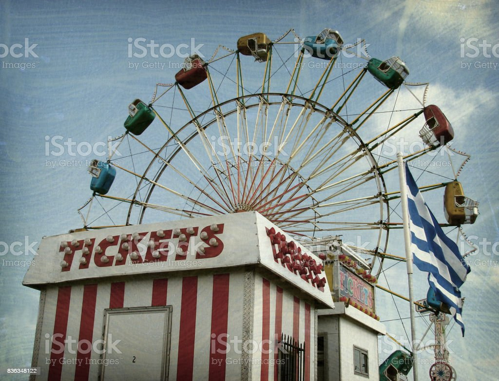 ticket booth and ferrsi wheel stock photo