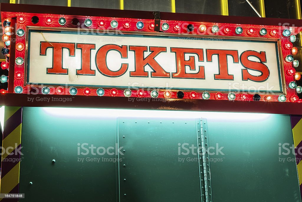 A ticket booth lights the midway at night at a fair stock photo