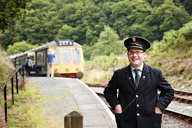 ticket collector at preserved uk railway - transport conductor stock photos and pictures