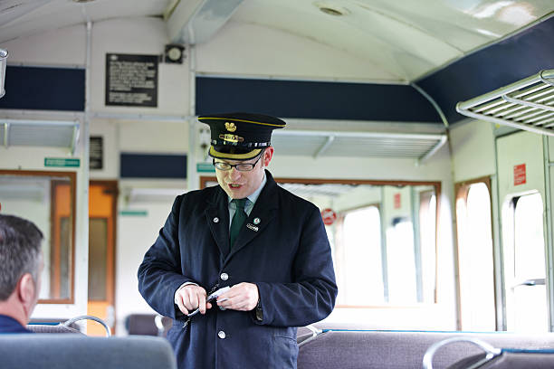 ticket collector at work on preserved uk railway - transport conductor stock photos and pictures