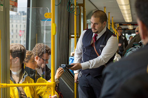 ticket collector on stockholm tram. - transport conductor stock photos and pictures