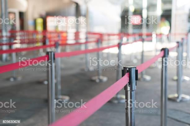 Ticket path for the show fence stainless barricade with red rope in picture id825630626?b=1&k=6&m=825630626&s=612x612&h=gt63nrc9zitssmcoxewz1xkfb6uv1g5bunkyk9xkora=