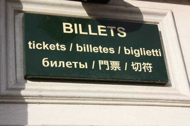 Cтоковое фото Ticket sales in several languages Outdoor shooting