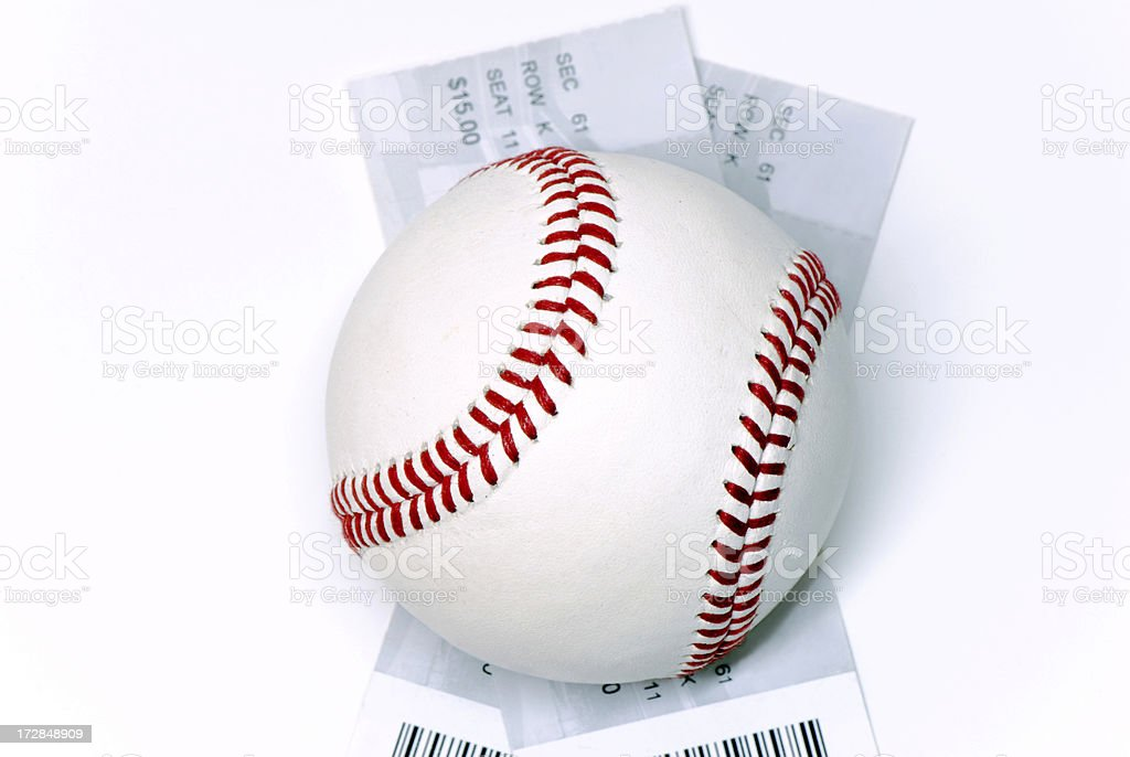 a baseball on top of 2 tickets to the game