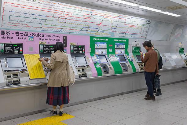 ticket vendor machine - gutschein bahn stock-fotos und bilder