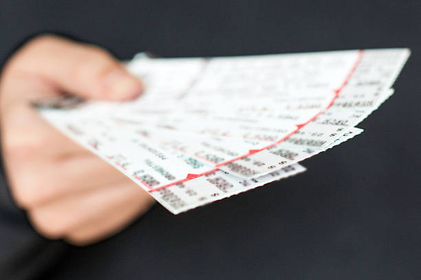 tickets in hand - ticket stock photos and pictures