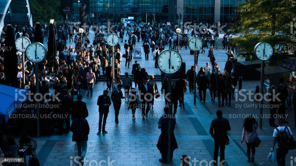 Ticking clocks at Canary Wharf during rush hour in London, UK stock photo