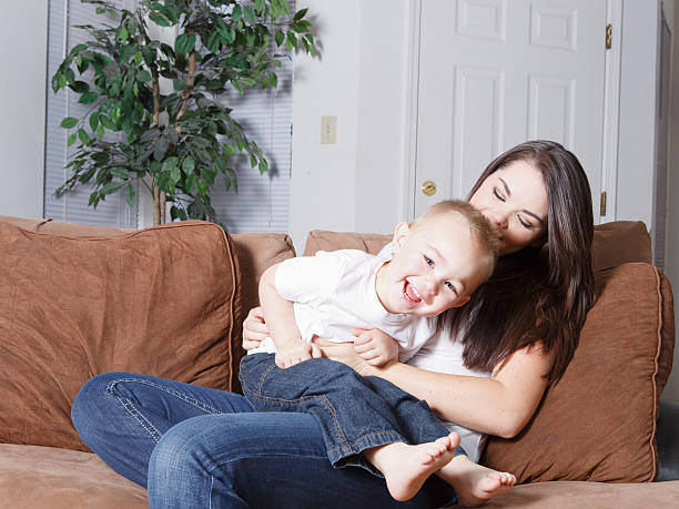 Tickle mother and son playtime stock photo