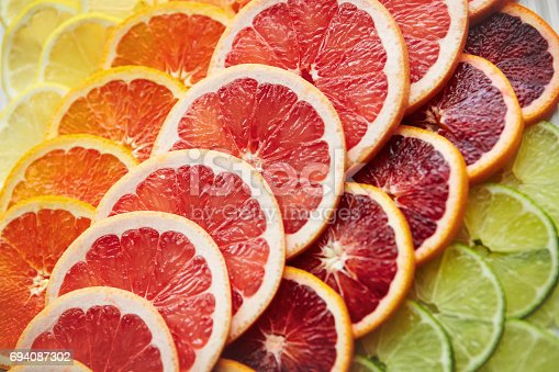 Shot of a variety of citrus fruits cut into slices
