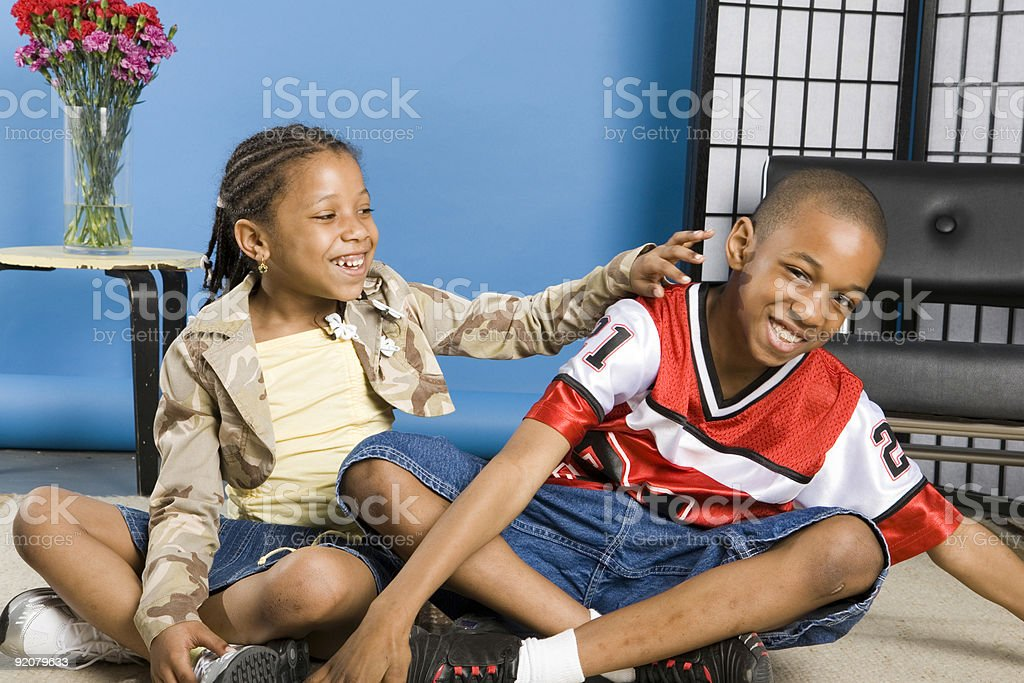 Tickling her brother royalty-free stock photo