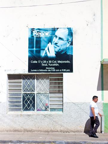 Ticul, Yucatan, Mexico: Man Walks Past Steve Jobs Banner