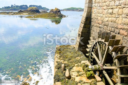 Ile de Bréhat at the Côtes d'Armor in Bretagne France during a beautiful summer day. Ile de Brehat is a popular tourist destination and a place to spend a vacation in one of the idyllic cottages.