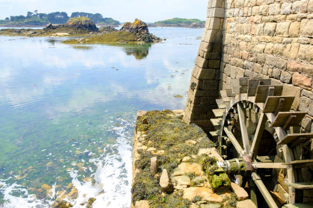 Tidal watermill at the Ile de Bréhat at the Côtes d'Armor in Bretagne France during summer stock photo
