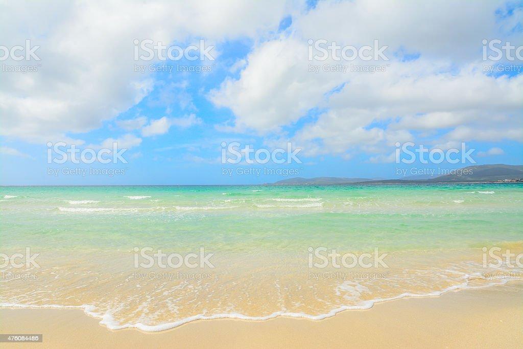 tide coming in Alghero shoreline stock photo