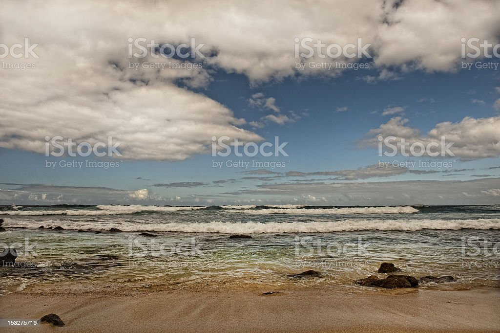 Tide going out on beach in Haleiwa, Hawaii royalty-free stock photo