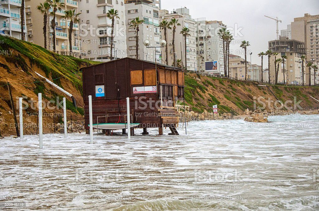 Tide is flooding at lifeguard station stock photo