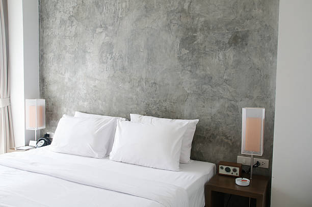 Tidy bed with bedside lamps stock photo
