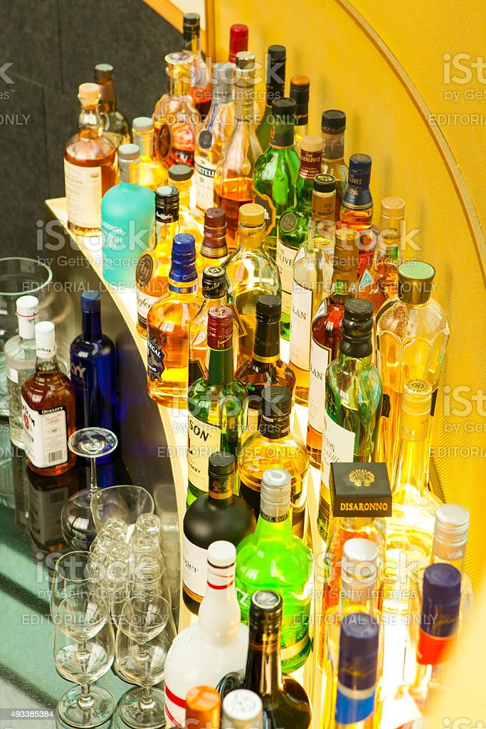 Tidy lots of liquor bottle alcohol with glass stock photo