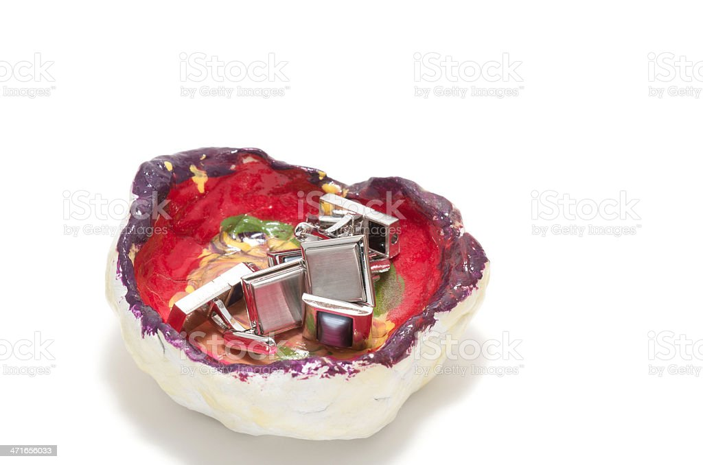Tidy sundries tray vide-poche with cufflinks inside stock photo