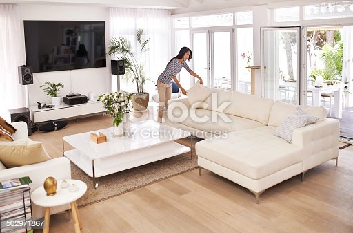 Shot of a young woman tidying her househttp://195.154.178.81/DATA/i_collage/pi/shoots/783499.jpg