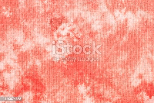 Abstract texture of tie dye cotton fabric coral color design. Coral color tie dye cotton texture