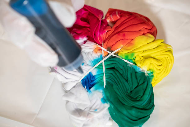 Tie dying a t shirt stock photo