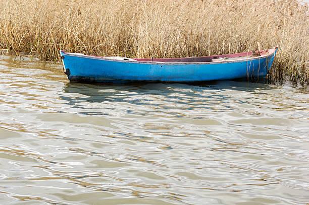 Tied fishing boat stock photo