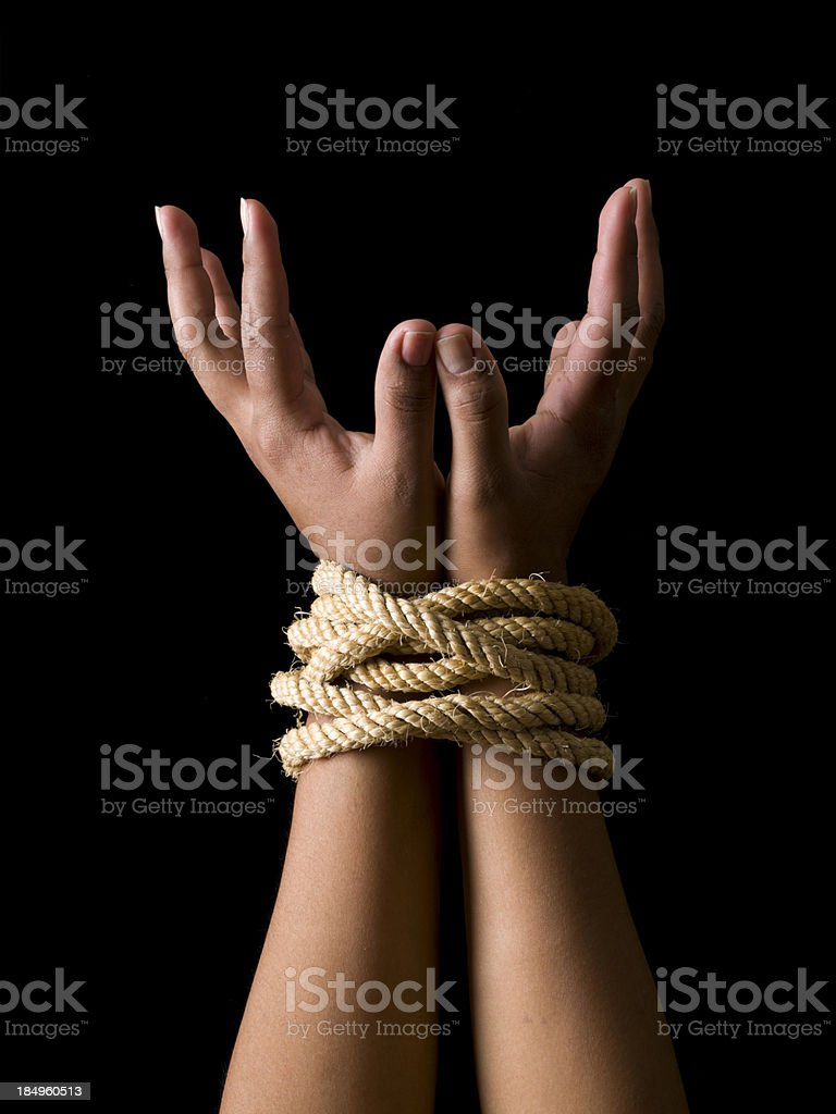 Tied hands stock photo