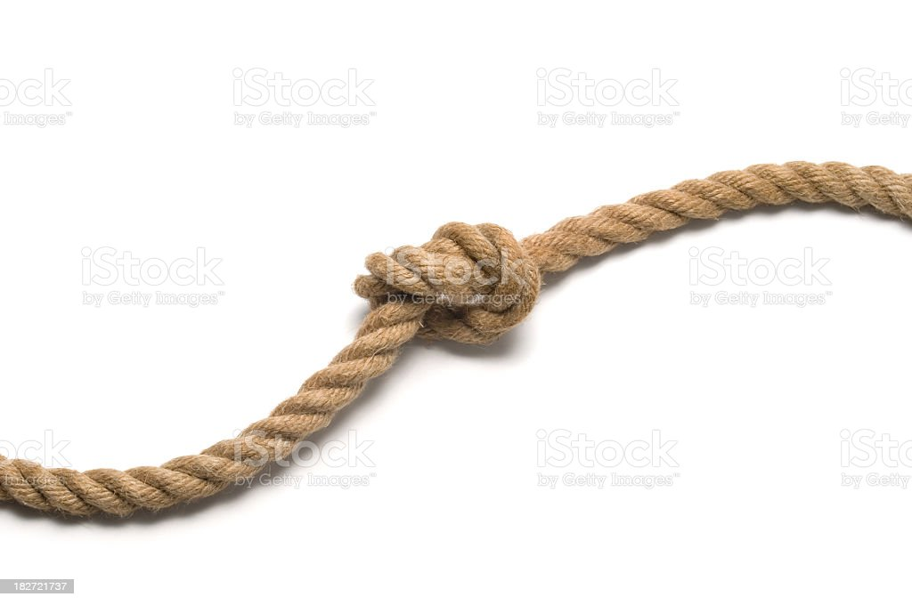 Tied knot on old rope royalty-free stock photo