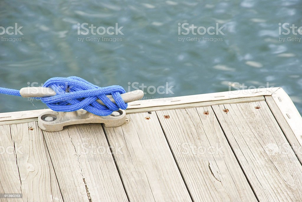 Tied to the dock stock photo
