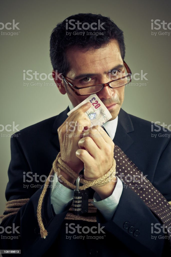 Tied Up Businessman Holding Money royalty-free stock photo
