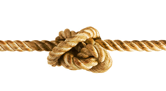 A rope or string tied into a tension knot and pulled tight, showing stress and difficulty. Isolated on a white background.