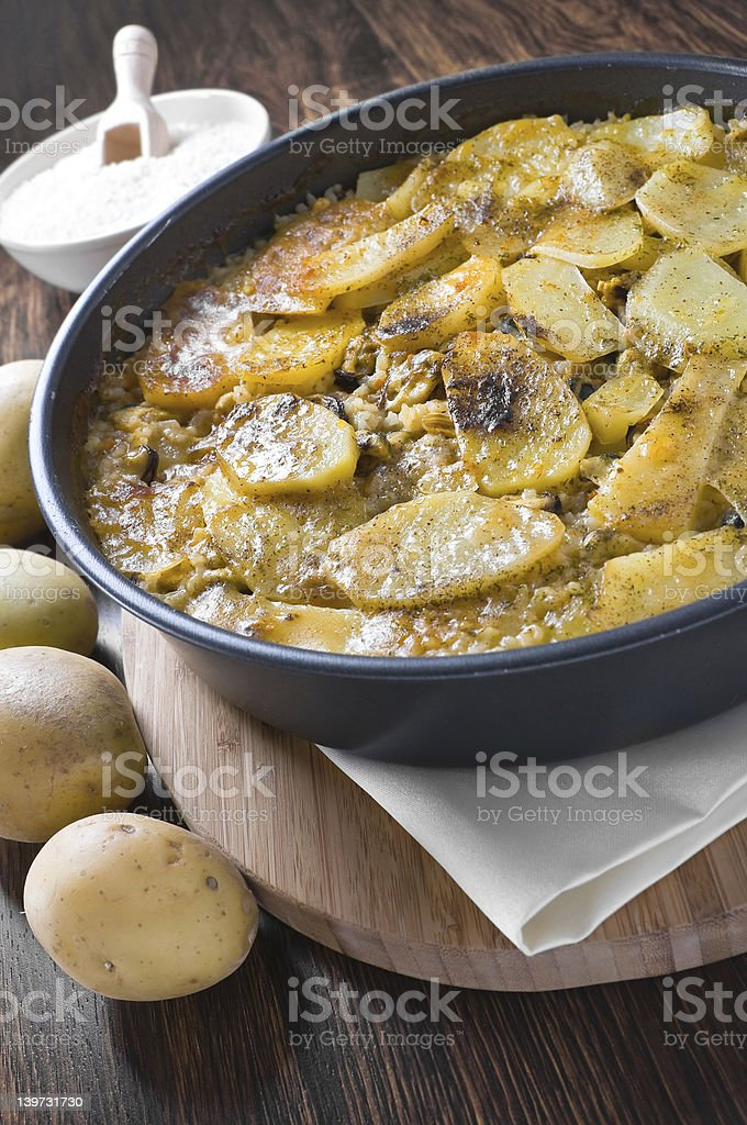 Tiella of potatoes, rice and mussels. royalty-free stock photo