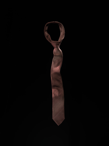 Ties for man on black background.