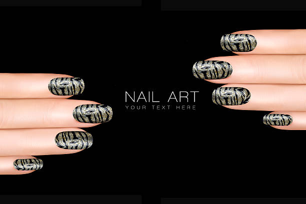 Tiger Nail Art. Nail Polish Stickers with Trendy Animal Print stock photo