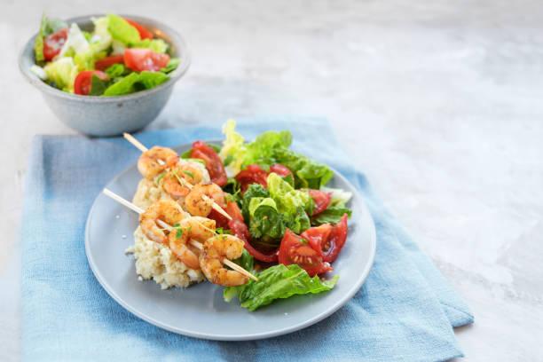 Tiger prawn skewers on cauliflower risotto with salad of lettuce and picture id1193945782?b=1&k=6&m=1193945782&s=612x612&w=0&h=gmvcohgrsug3fg6naks7msl4mankylgsmn31vviq2vu=