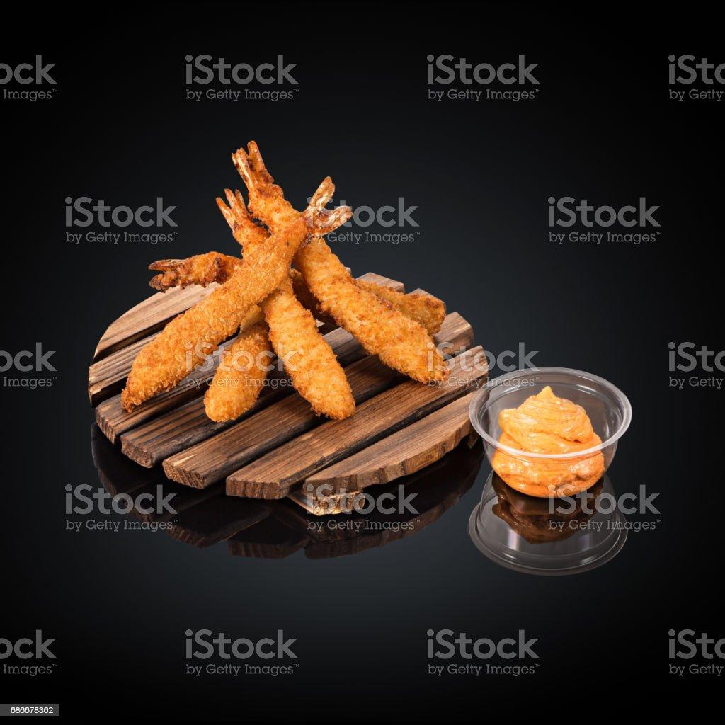 Tiger prawns in batter, spicy sauce stock photo