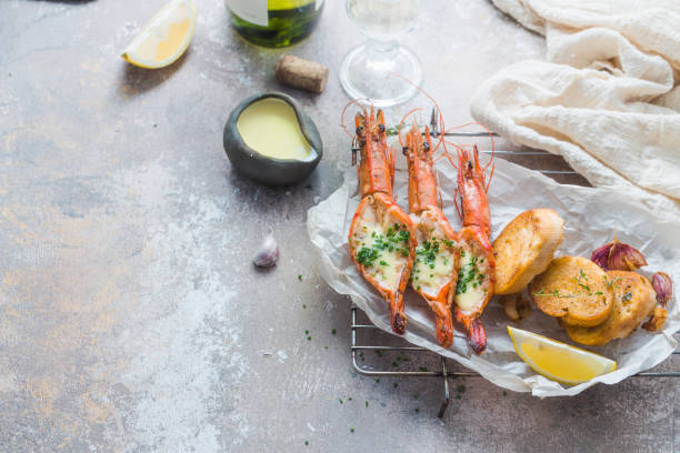Tiger prawns with garlic sauce and bread, copy space stock photo