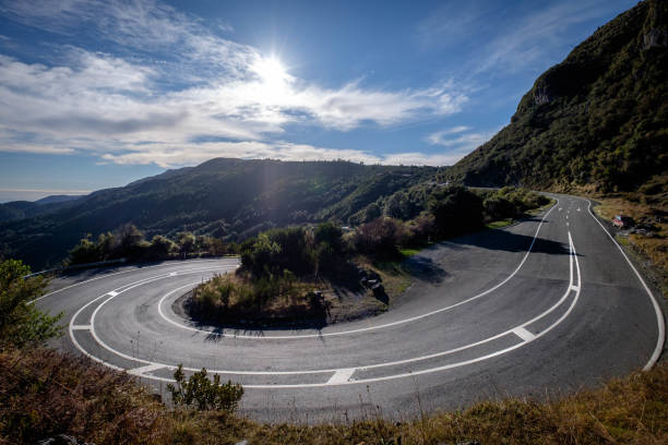A tight bend along mountain road. stock photo