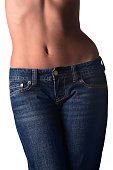 Young fit woman wearing tight Blue Jeans. Image isolated on white with Clipping Path-