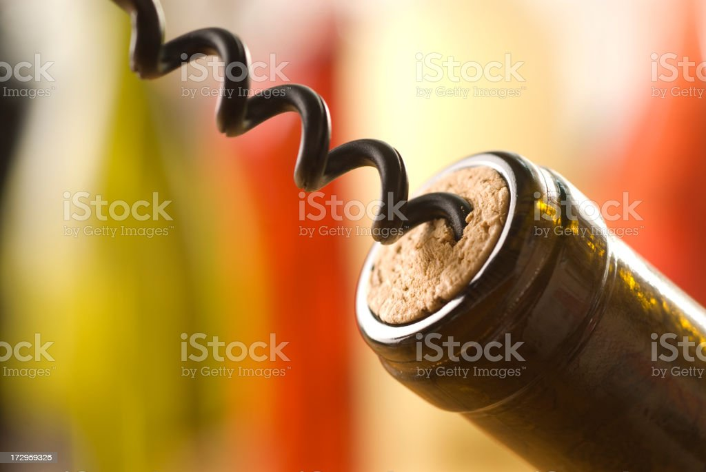 Tight shot of a Cork Screw in a wine bottle royalty-free stock photo