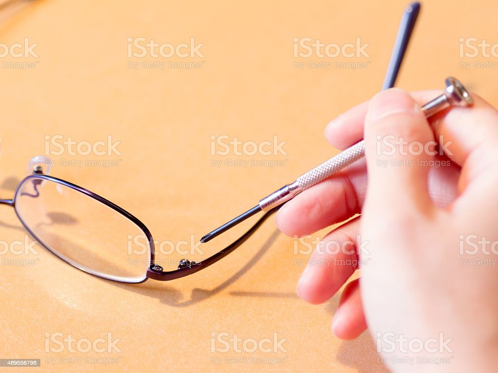 Tighten A Screw On The Blue Metal Frame Glasses Stock Photo Download Image Now Istock