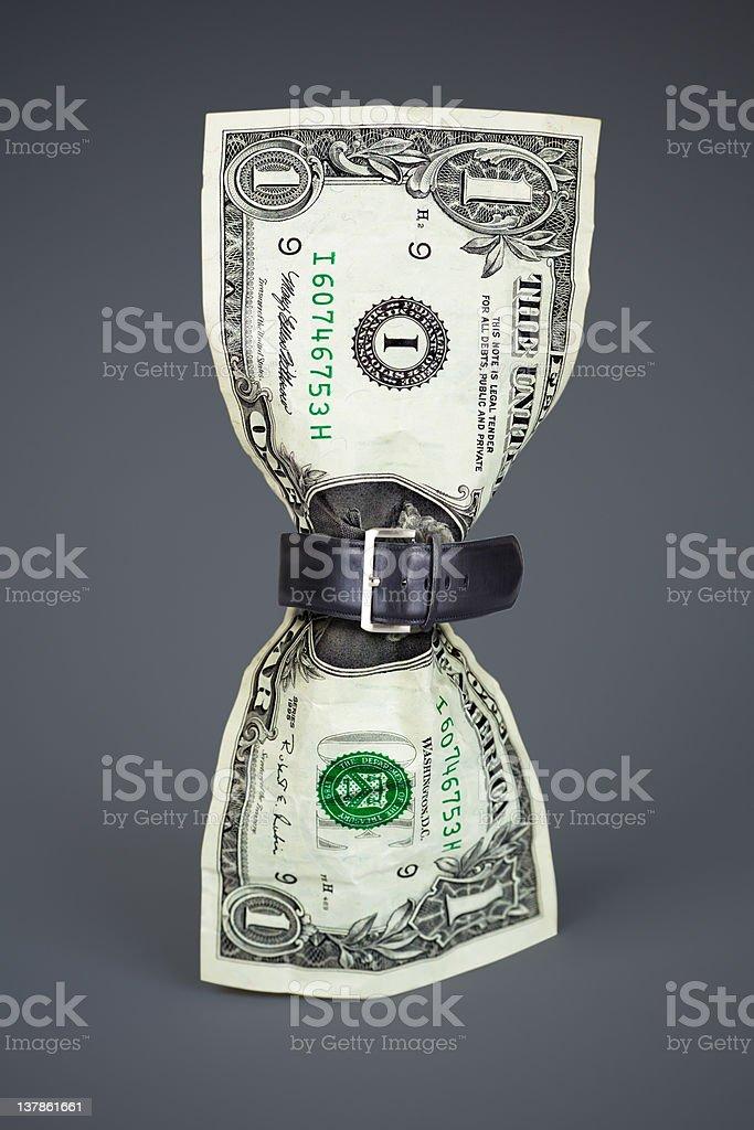 tighten belt on dollar concept royalty-free stock photo