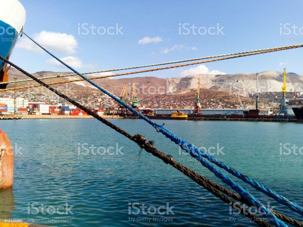 Tightened mooring ropes. Mooring of the ship stock photo