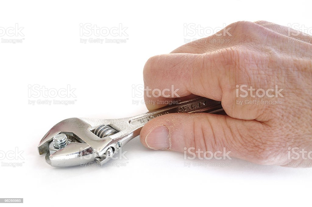 Tightening a Nut Using an Adjustable Wrench royalty-free stock photo