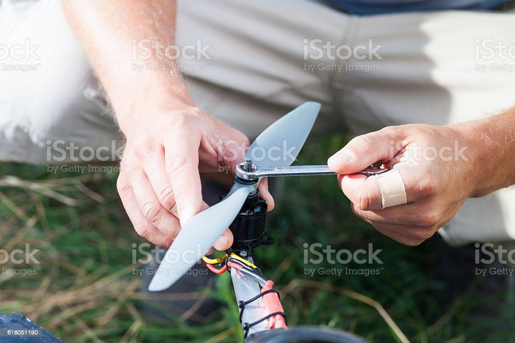 tightening a quadcopter propeller stock photo