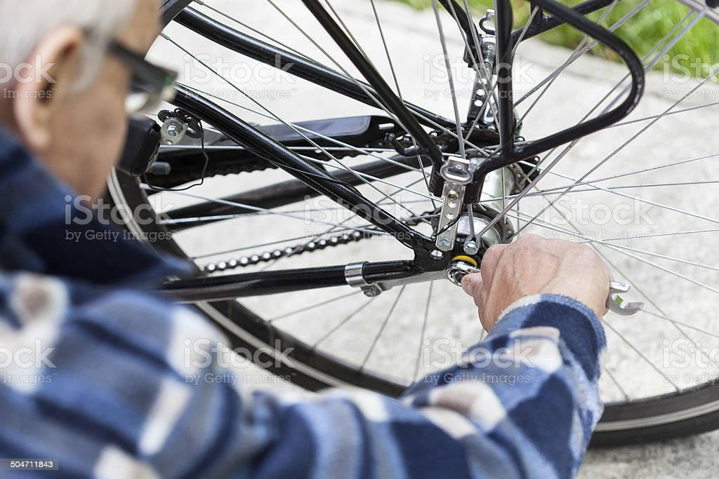 Tightening the bolts on a bicycle wheel stock photo