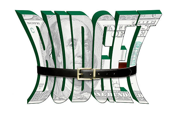 Tightening the budget belt stock photo