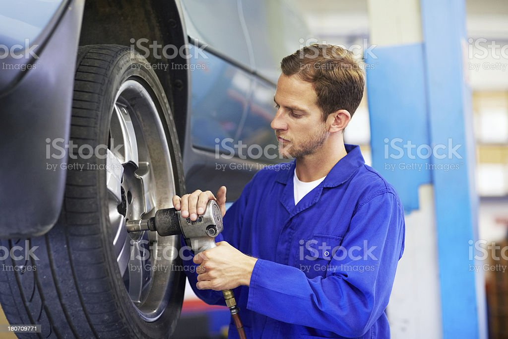 Tightening the lug nuts stock photo
